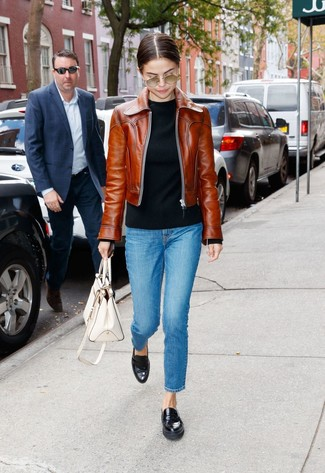 How to Wear a Brown Leather Bomber Jacket For Women: Teaming a brown leather bomber jacket with blue jeans is an awesome option for a casually edgy ensemble. If you need to instantly glam up your ensemble with one piece, why not complement your look with black leather loafers?