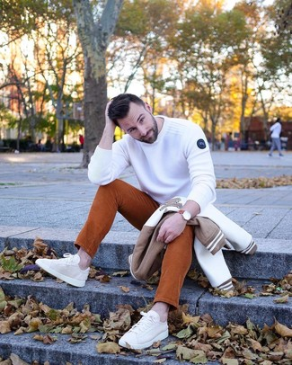 How to wear: white and brown bomber jacket, white crew-neck sweater, tobacco corduroy jeans, beige canvas low top sneakers