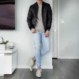 Beige Crew-neck Sweater Outfits For Men: Opt for a beige crew-neck sweater and light blue ripped jeans for a relaxed take on day-to-day menswear. Ramp up the classiness of this getup a bit by slipping into a pair of grey canvas low top sneakers.