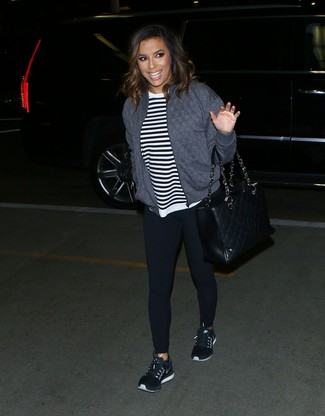 This pairing of a white and black horizontal striped crew-neck sweater and black leggings gives off a very casual and approachable vibe. Grab a pair of black athletic shoes to make the look current. It's is a savvy pick if you're putting together a standout look for awkward fall weather.
