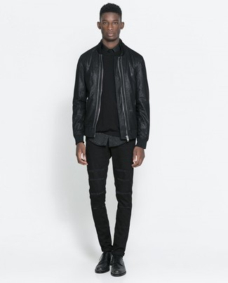 How to wear: black leather bomber jacket, black crew-neck sweater, black leopard long sleeve shirt, black jeans