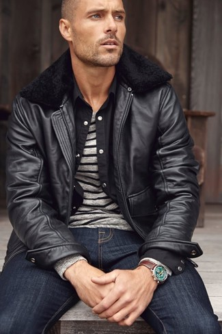 How To Wear a Black Leather Bomber Jacket With Navy Jeans For Men: Make a black leather bomber jacket and navy jeans your outfit choice to show off your styling smarts.