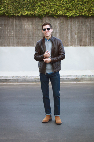 How to Wear a Tobacco Leather Bomber Jacket For Men: Teaming a tobacco leather bomber jacket and navy jeans will hallmark your expertise in menswear styling even on lazy days. If you need to instantly perk up this outfit with one single piece, complete this outfit with a pair of tan suede chelsea boots.
