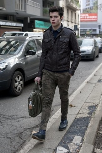 How to wear: black leather bomber jacket, navy crew-neck sweater, grey long sleeve shirt, olive camouflage chinos