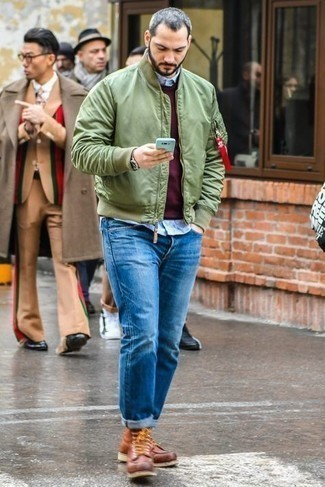 Brown Leather Casual Boots Outfits For Men: For relaxed dressing with a modern finish, team an olive bomber jacket with blue jeans. Channel your inner Ryan Gosling and smarten up your ensemble with brown leather casual boots.