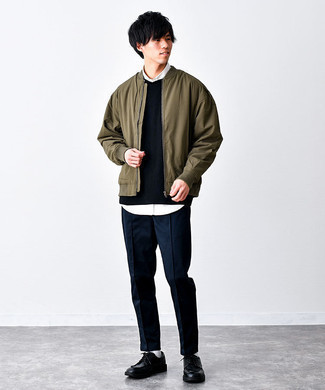 Olive Bomber Jacket Outfits For Men: This casual combo of an olive bomber jacket and navy chinos is capable of taking on different moods according to how it's styled. Why not introduce a pair of black leather derby shoes to your ensemble for an extra touch of style?