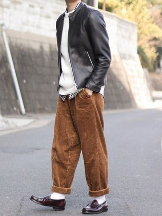 White Crew-neck Sweater Outfits For Men: If you're searching for a laid-back yet on-trend getup, reach for a white crew-neck sweater and brown corduroy chinos. And if you want to immediately perk up your ensemble with footwear, add burgundy leather loafers to the equation.