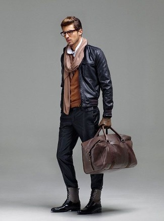 A black leather bomber jacket and black chinos are a go-to pairing for many style-conscious guys. To bring a bit of fanciness to this ensemble, complement your outfit with a pair of black leather casual boots.