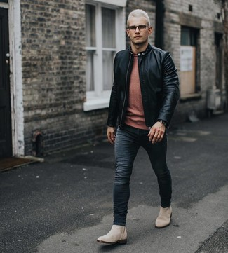How to wear: black leather bomber jacket, orange crew-neck sweater, black skinny jeans, beige suede chelsea boots