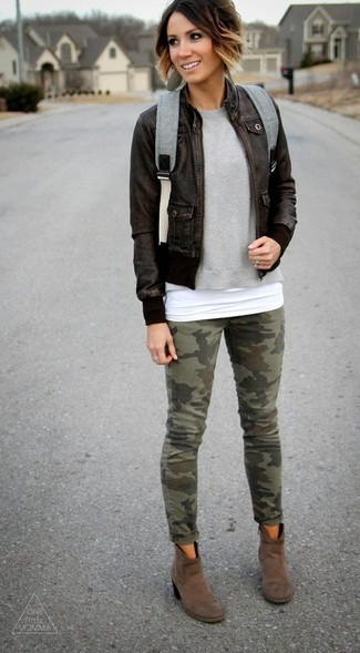 How to wear: dark brown leather bomber jacket, grey crew-neck sweater, white tank, olive camouflage skinny jeans