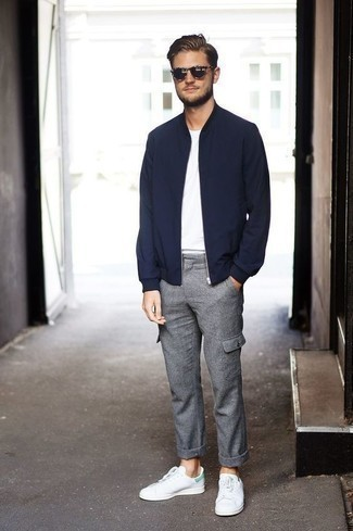 How to Wear a Navy Bomber Jacket For Men: A navy bomber jacket and grey wool cargo pants worn together are a match made in heaven for those who love cool and relaxed ensembles. As for footwear, introduce white and green leather low top sneakers to your outfit.