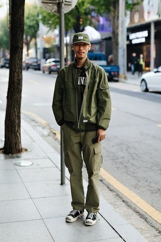 How to Wear an Olive Camouflage Crew-neck T-shirt For Men: This pairing of an olive camouflage crew-neck t-shirt and olive cargo pants is ideal for lazy days. To give your overall outfit a more elegant spin, complement your look with black and white canvas low top sneakers.