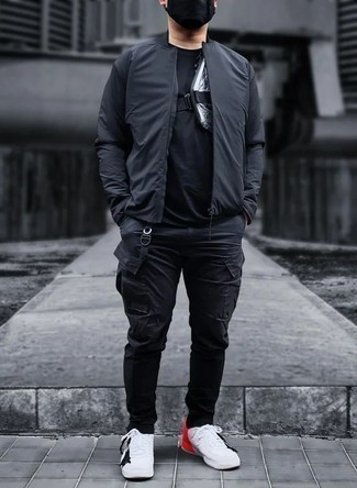 Black Crew-neck T-shirt Outfits For Men: Why not pair a black crew-neck t-shirt with black cargo pants? These two items are totally comfortable and will look awesome combined together. If not sure about the footwear, go with a pair of white and red canvas low top sneakers.
