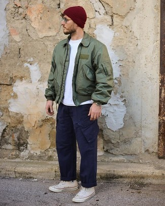 Burgundy Beanie Outfits For Men: An olive bomber jacket and a burgundy beanie are a cool outfit that will effortlessly carry you throughout the day and into the night. White canvas high top sneakers are a simple way to upgrade this outfit.