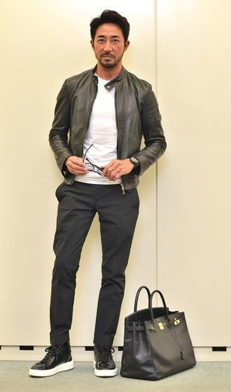 How to wear: black leather bomber jacket, white crew-neck t-shirt, black chinos, black leather high top sneakers