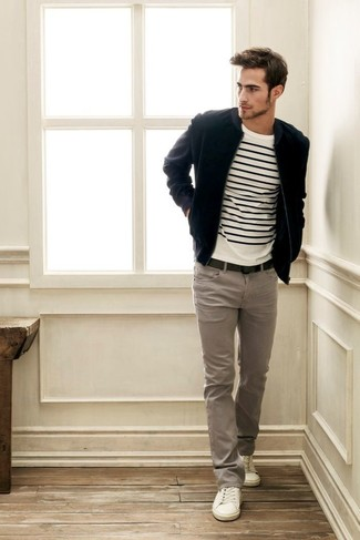 The versatility of a black suede bomber jacket and grey casual trousers makes them investment-worthy pieces. A pair of white low top sneakers brings the dressed-down touch to the ensemble. So so as you can see, it's a neat, not to mention spring-ready, look to have in your transitional rotation.