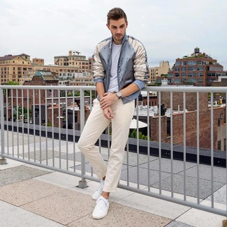 How to wear: grey satin bomber jacket, white crew-neck t-shirt, beige chinos, white low top sneakers