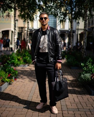 How to wear: black leather bomber jacket, black and white print crew-neck t-shirt, black chinos, white print leather low top sneakers