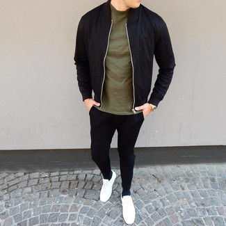 How to wear: black bomber jacket, olive crew-neck t-shirt, black chinos, white low top sneakers