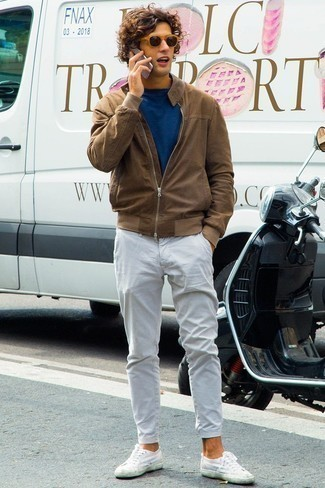 How to Wear a Brown Bomber Jacket For Men: A brown bomber jacket and white chinos are absolute menswear staples if you're figuring out a casual closet that holds to the highest sartorial standards. And if you wish to effortlesslly play down your outfit with shoes, add a pair of white canvas low top sneakers to the equation.
