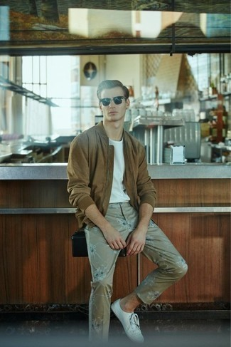 How to Wear White Canvas Low Top Sneakers For Men: Why not try teaming a brown suede bomber jacket with beige print chinos? As well as very comfortable, both of these pieces look amazing combined together. If you're puzzled as to how to finish off, introduce white canvas low top sneakers to your ensemble.