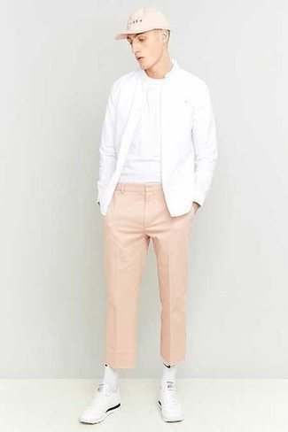 White Bomber Jacket Outfits For Men: For stylish menswear style without the need to sacrifice on practicality, we like this combo of a white bomber jacket and pink chinos. As for the shoes, you could take the casual route with a pair of white athletic shoes.