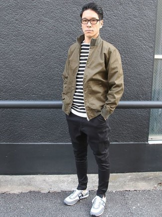 How to Wear a Brown Bomber Jacket For Men: Go for a simple but casually stylish option by wearing a brown bomber jacket and black chinos. Finishing with white and blue athletic shoes is a surefire way to infuse a sense of stylish effortlessness into this getup.