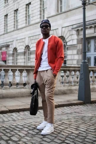 How to Wear a Red Bomber Jacket For Men: A red bomber jacket and khaki chinos are a nice pairing worth incorporating into your day-to-day fashion mix. Introduce a pair of white canvas low top sneakers to the mix to immediately rev up the cool of your ensemble.