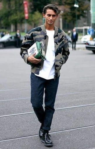 How to Wear an Olive Camouflage Bomber Jacket For Men: Parade your skills in menswear styling by combining an olive camouflage bomber jacket and navy chinos for a laid-back getup. Black leather casual boots will bring a refined aesthetic to the getup.