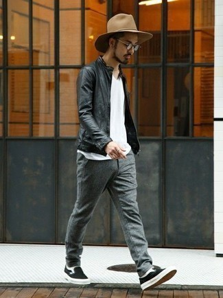 How to Wear a Black Leather Bomber Jacket For Men: For a casual ensemble, reach for a black leather bomber jacket and grey wool chinos — these items fit wonderfully together. Introduce a pair of black canvas slip-on sneakers to the mix for extra fashion points.