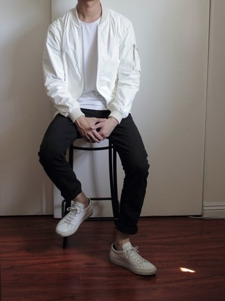 White Bomber Jacket Outfits For Men: Go for a white bomber jacket and black chinos for a relaxed casual menswear style with a modern spin. Why not complement this outfit with a pair of white canvas low top sneakers for a sense of stylish casualness?