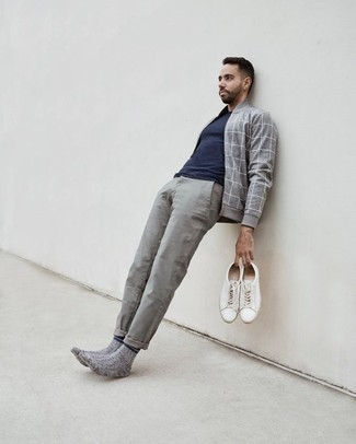Men's Looks & Outfits: What To Wear In 2020: If the situation allows an off-duty getup, wear a grey check bomber jacket with grey chinos. White canvas low top sneakers are a savvy option to round off this look.