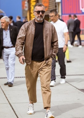 500+ Outfits For Men After 50: If you prefer laid-back style, why not pair a brown leather bomber jacket with khaki chinos? To infuse a more casual touch into your look, add white and black athletic shoes to the mix. Now that's how you dress casually in your fifties.