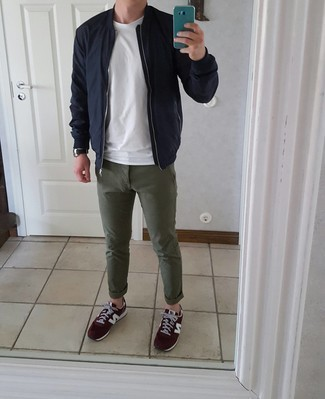 Olive Chinos Outfits In Their 20s: Opt for a navy bomber jacket and olive chinos for a comfy getup that's also pulled together nicely. For something more on the cool and laid-back end to round off this outfit, add burgundy athletic shoes to your getup. Perfect if you're looking for some amazingly inspiring 20-somethin style.