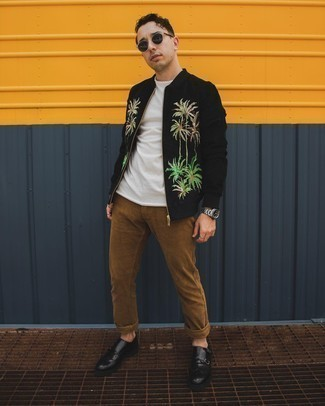 Khaki Chinos Outfits: A black embroidered bomber jacket and khaki chinos are the kind of a no-brainer casual getup that you so terribly need when you have no extra time. Choose a pair of black leather double monks for an extra dose of sophistication.