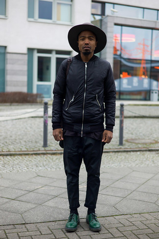 Dark Brown Wool Hat Outfits For Men: Inject some fun into your daily styling arsenal with a black bomber jacket and a dark brown wool hat. Complete this look with a pair of dark green leather derby shoes to immediately dial up the style factor of any ensemble.