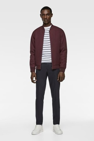 Burgundy Bomber Jacket Outfits For Men: For a surefire off-duty option, you can't go wrong with this combo of a burgundy bomber jacket and black chinos. Why not complement your getup with a pair of white leather low top sneakers for a laid-back vibe?