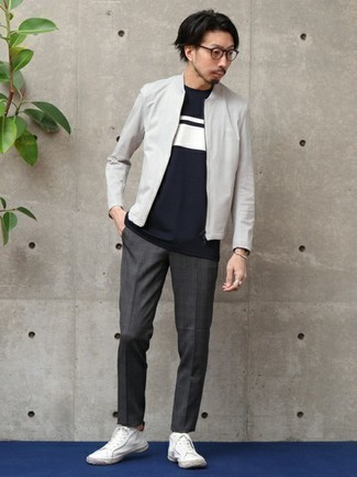 Grey Bomber Jacket Outfits For Men In Their 30s: A grey bomber jacket and charcoal plaid chinos worn together are a perfect match. White canvas low top sneakers are a great idea to round off your look. Perfect if you're looking for some seriously inspiring over-30 off-duty style.