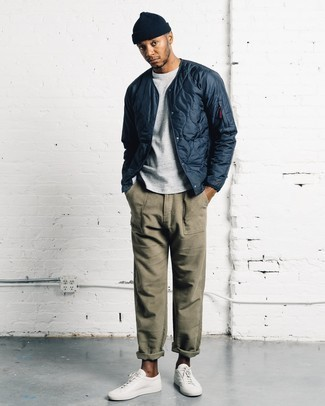 White and Red Leather Low Top Sneakers Outfits For Men: A navy quilted bomber jacket and olive chinos are a wonderful combination to add to your casual rotation. A pair of white and red leather low top sneakers will tie your full getup together.