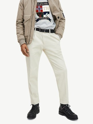 Men's Outfits 2021: This off-duty combo of a tan bomber jacket and white chinos is very easy to put together without a second thought, helping you look amazing and ready for anything without spending a ton of time going through your wardrobe. If you need to immediately tone down this outfit with shoes, introduce a pair of black leather work boots to this ensemble.