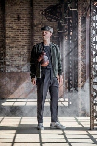Flat Cap Outfits For Men: This combination of a dark green bomber jacket and a flat cap is proof that a pared down casual look can still be really interesting. And if you need to instantly up your ensemble with shoes, add a pair of grey leather high top sneakers to this look.