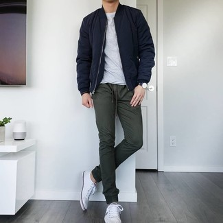 Dark Green Chinos Outfits: Fashionable and functional, this laid-back combo of a navy quilted bomber jacket and dark green chinos will provide you with variety. A pair of white canvas low top sneakers is a good pick to round off your getup.