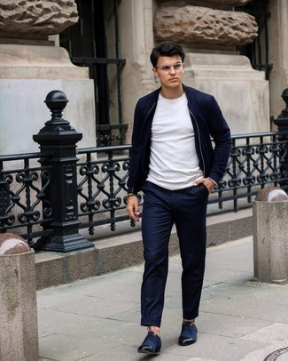 Navy Chinos Outfits: If you appreciate functional menswear, dress in a navy bomber jacket and navy chinos. A pair of navy canvas derby shoes will take your look down a more sophisticated path.
