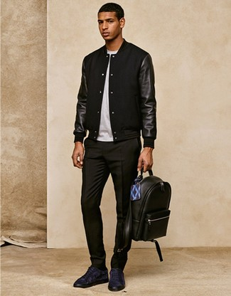 How to wear: black bomber jacket, white crew-neck t-shirt, black dress pants, navy suede low top sneakers
