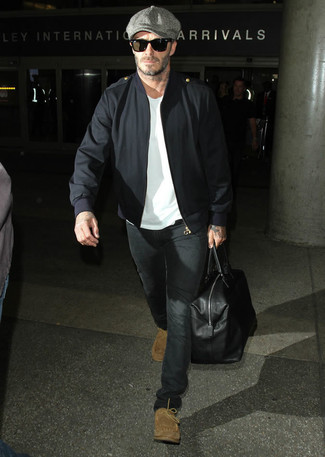 David Beckham wearing Black Bomber Jacket, White Crew-neck T-shirt, Black Jeans, Tan Suede Desert Boots