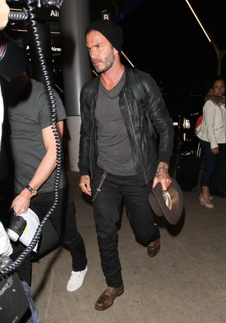 David Beckham wearing Black Leather Bomber Jacket, Charcoal Crew-neck T-shirt, Black Jeans, Dark Brown Leather Derby Shoes