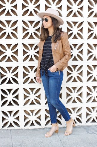 How to wear: tan leather bomber jacket, black and white horizontal striped crew-neck t-shirt, blue jeans, tan leather heeled sandals