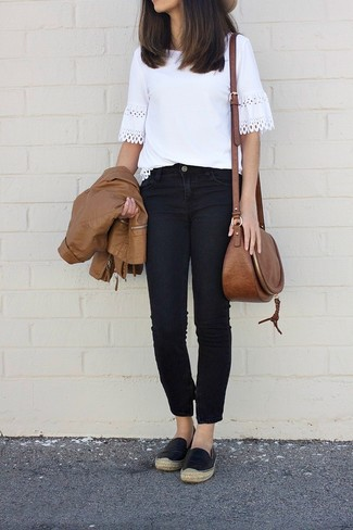 How to wear: brown leather bomber jacket, white crochet crew-neck t-shirt, black jeans, black leather espadrilles