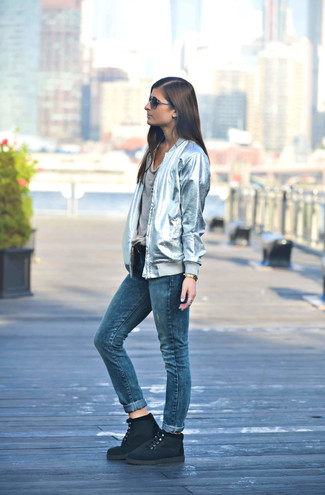 How to wear: silver bomber jacket, grey crew-neck t-shirt, blue jeans, black suede lace-up flat boots