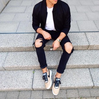 How to wear: black bomber jacket, white crew-neck t-shirt, black ripped jeans, tan low top sneakers